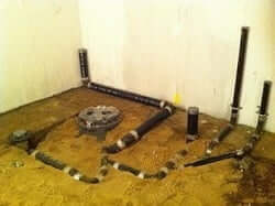 HOW TO LAY OUT A WATER LINE THROUGH A BASEMENT WALL