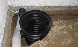 INSTALLING A SUMP PUMP SYSTEM IN BASEMENT